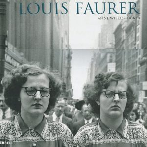"""Louis Faurer was one of America's """"quiet"""" photographers. Known for his raw, melancholy, and psychologically charged pictures of life on the street, and in particular for his evocative shots of 1940s and 1950s Times Square, New York, Faurer frequently drew on the film noir idiom to create memorable images. Photographs of moviegoers, box-office lines, ushers, and cinemas advertising B movies such as Force of Evil, Edge of Doom, and Ace in the Hole are recurrent themes."""" """"Much of Faurer's best work, though, is of ordinary people, and he frequently haunted the streets of New York, finding poetry amid the crackle of the city. In an untitled picture taken in 1937 in Philadelphia, the trousers, jacket cuffs, and cane of a seated man are in sharp focus, as are a box of pencils and a sign announcing """"I am totally blind."""""""